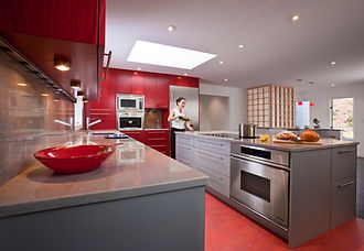 red kitchen, modern kitchen, marmoleum flooring, stainless steel appliances, quartz countertops, tabu vaneer, gray laminate, decor oven, miele refrigerator, miele cappuccino machine