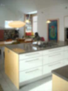 drop pendant lighting, stainless steel appliances, caesarstone countertops, laminate
