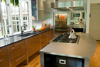 stainless steel countertops, wood floor, stainless steel appliances, stainless steel refrigerator
