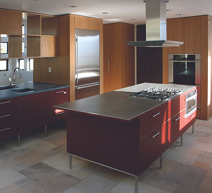 Red kitchen, modern kitchen, stainless steel appliances, stainless steel countertops, stainless steel hood, stainless steel refrigerator