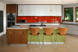 Modern kitchen, red kitchen, wooden chairs, pendant lights, caesarstone countertop, maple flooring
