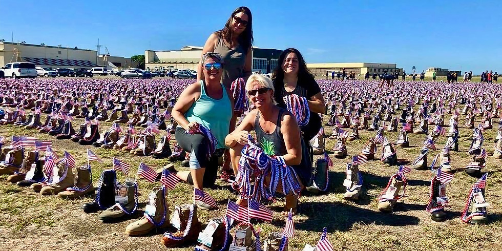 Placing Boots for Hero Remembrance Display