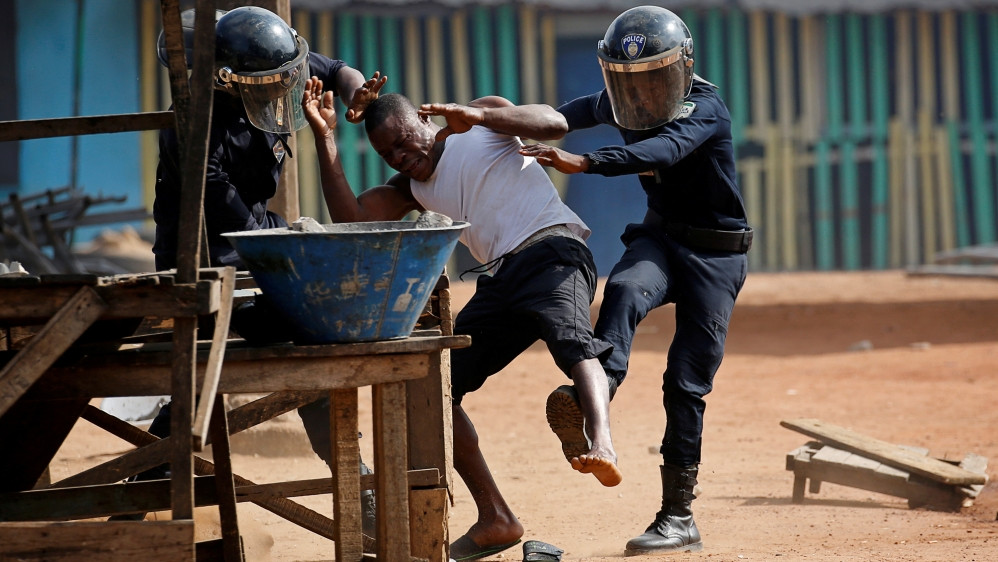 Police detain a demonstrator during an August 13 protest in Abidjan against Ouattara's decision to stand for a third term [Luc Gnago/Reuters]