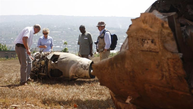 French investigators examine the wreckage of Habyarimana's Dassault Falcon 50 plane (Hereward Holland/Reuters)