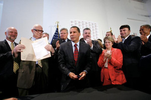 Governor Paterson signs the Dignity