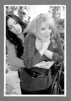 Deliberately aged photograph of Dr, Eryn Newman performing the Heimlich Manoeuvre on Professor Elizabeth Loftus, 2012.