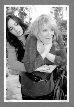 Scans of deliberately aged photograph of Dr. Eryn Newman performing the Heimlich Manoeuvre on Professor Elizabeth Loftus