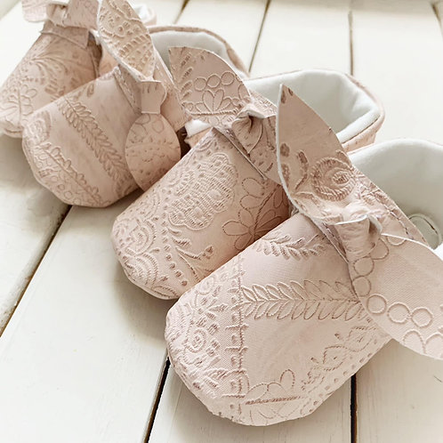 Blush embossed knot bow moccasins