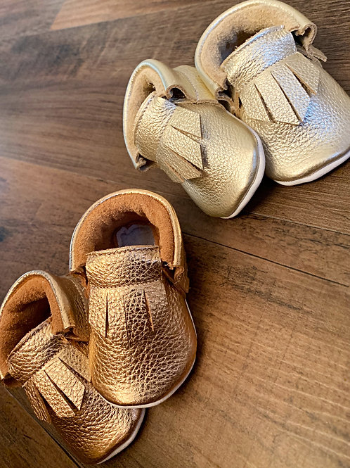 Rose or pale gold moccasins
