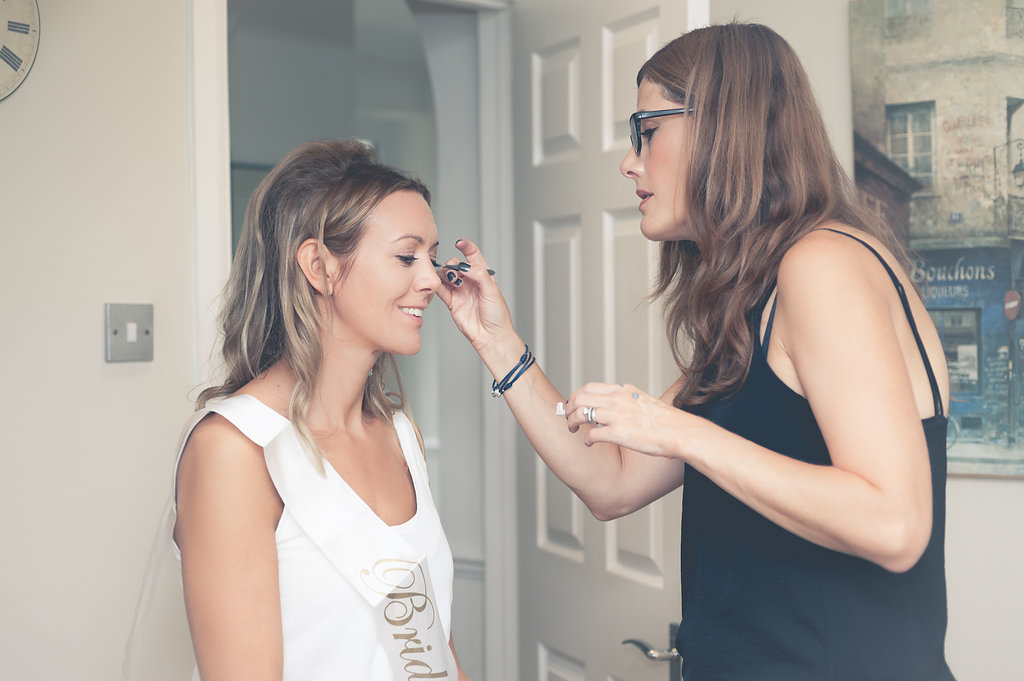 Bridal makeup artist in action