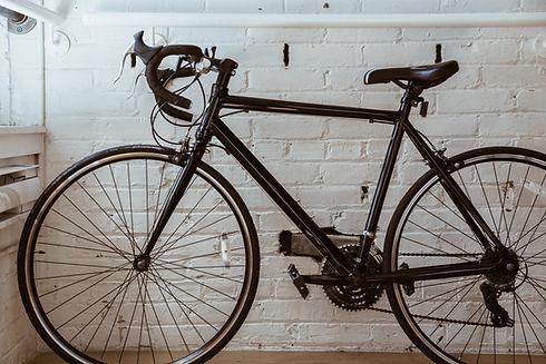 black bike white brick wall.jpg