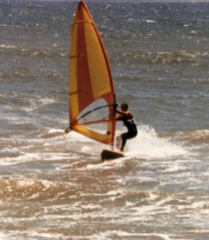 Cafrosboom windsurfing in San Pedro, CA - Cabrillo Ocean beach. Jibing around small wind swell.