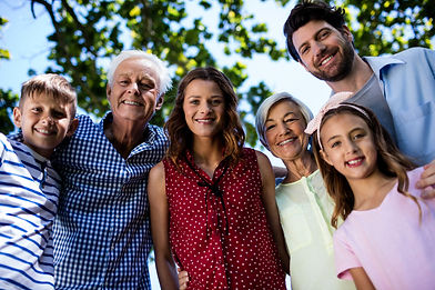 multi-generation-family-standing-in-park