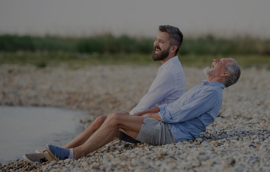senior-father-and-mature-son-sitting-by-