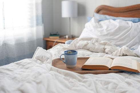 tray-with-tea-and-a-book-on-cozy-unmade-bed-relaxing-home-morning-weekend-lifestyle-unwind