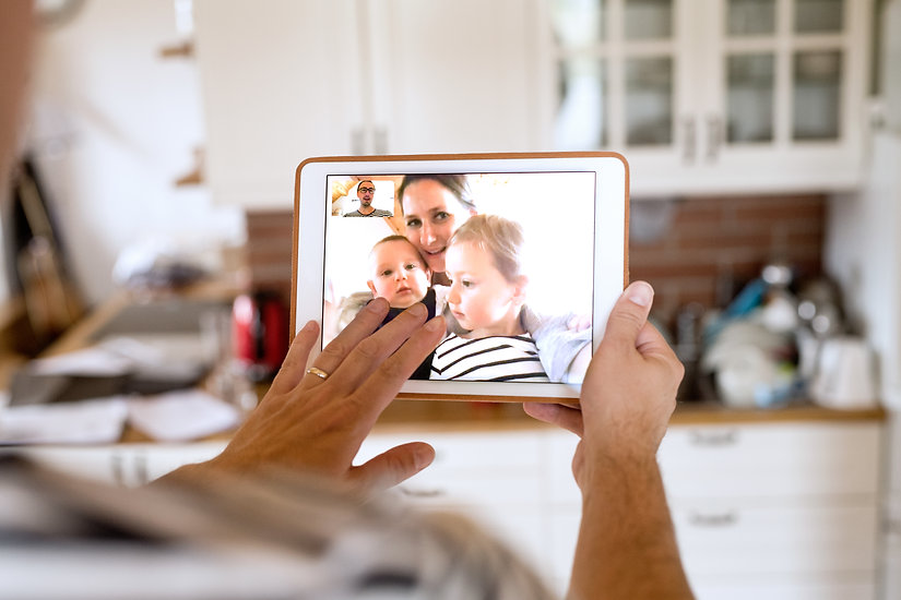 father-at-home-with-tablet-video-chattin