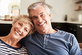senior-couple-relaxing-at-home-smiling-t