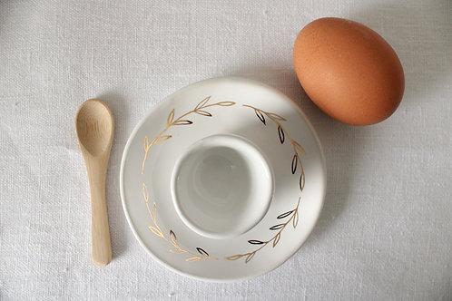 Coquetier céramique avec feuillage or