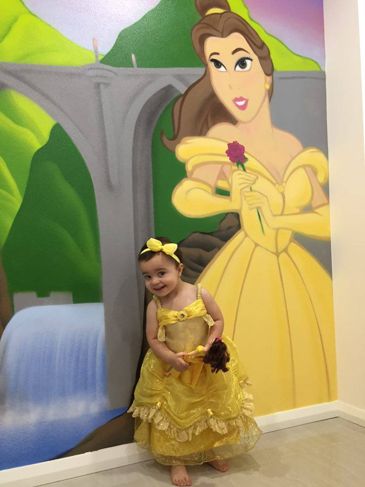 little girl and her new Disney mural