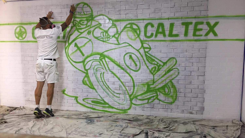 Street artist painting motorcycle