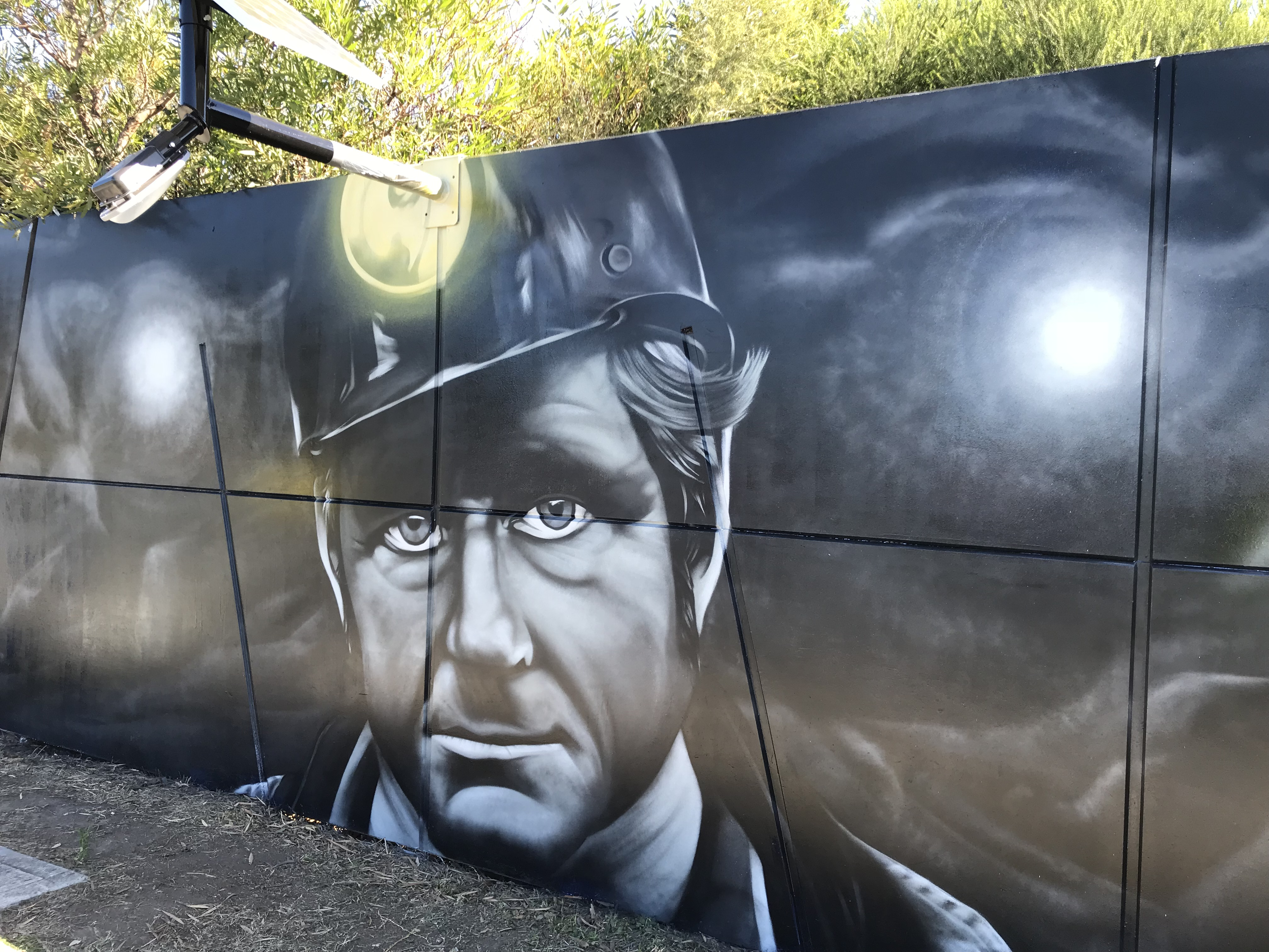 Street art mural portrait of miner
