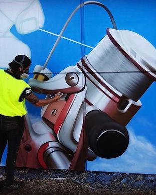 artist painting graffiti art mural