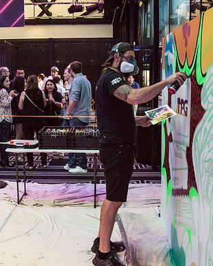 graffiti artist painting live at event