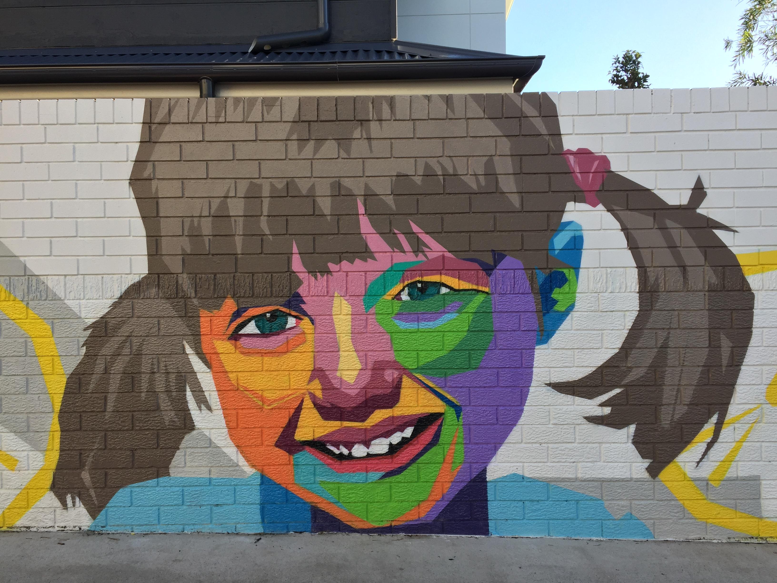 Little girl painted in mural artwork