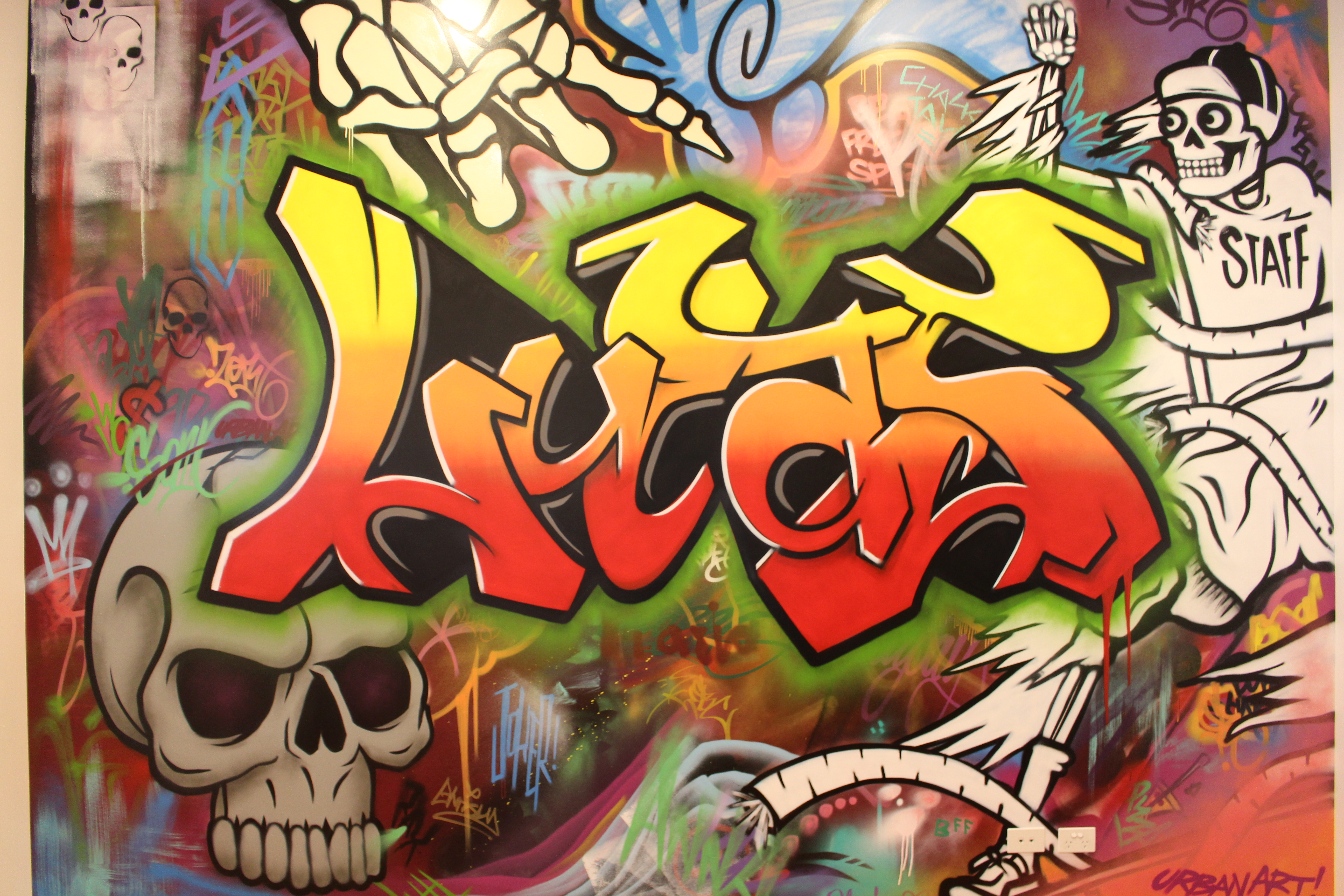Kids graffiti name painted bedroom