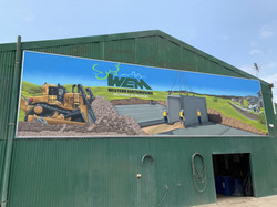 construction building street art mural by Urban A