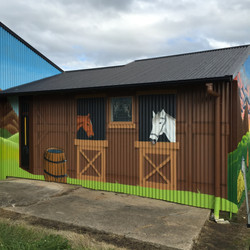 horses in shed mural art