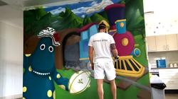 Sydney street artist painting mural