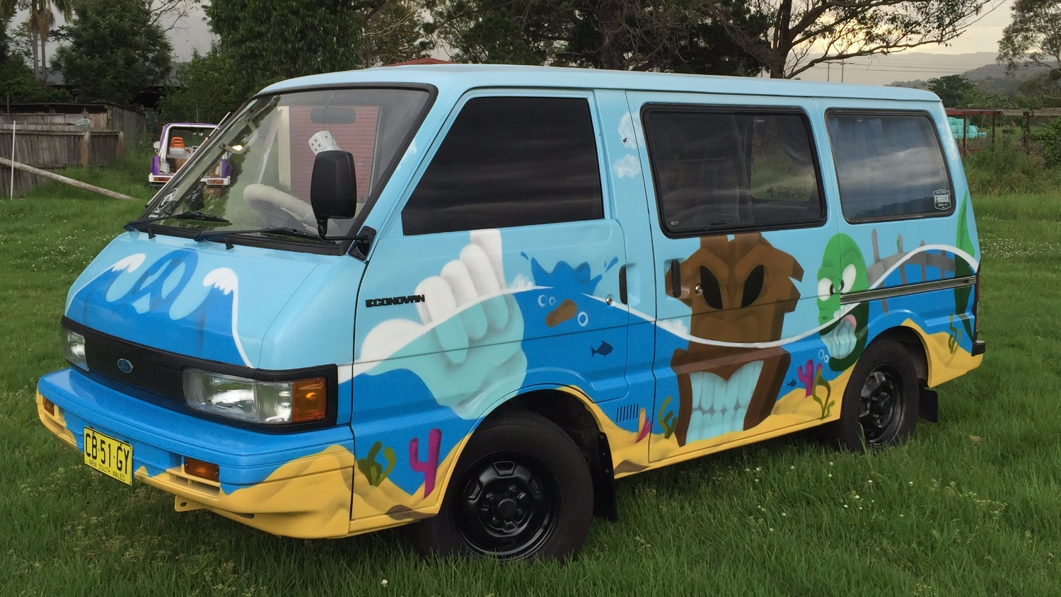 Underwater themed mural on van