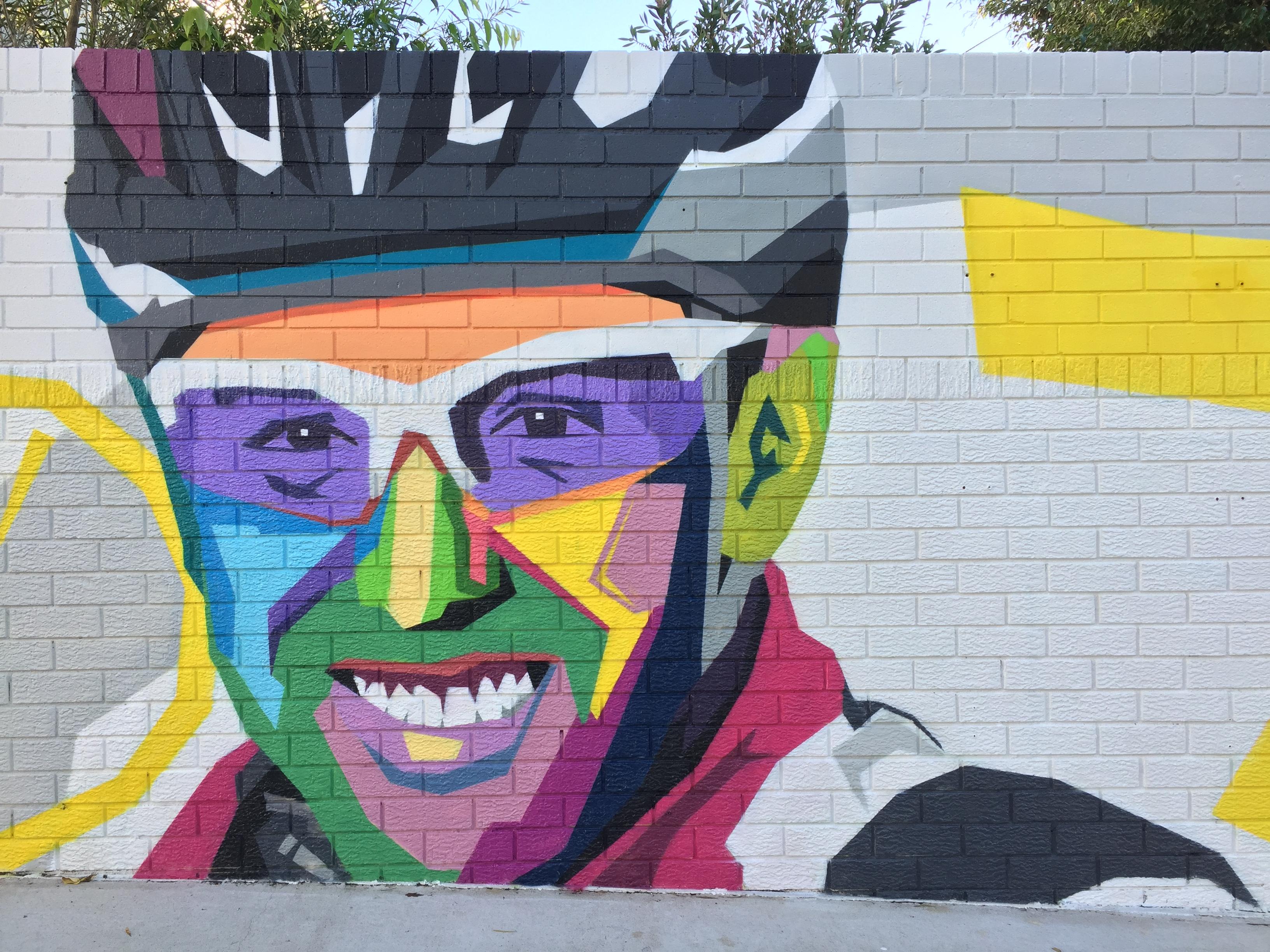 Cyclist in Tour De Cure mural art