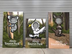 wildlife animals head in hole mural art