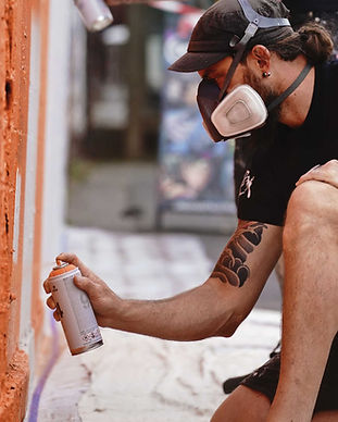 Street artist hand painting mural