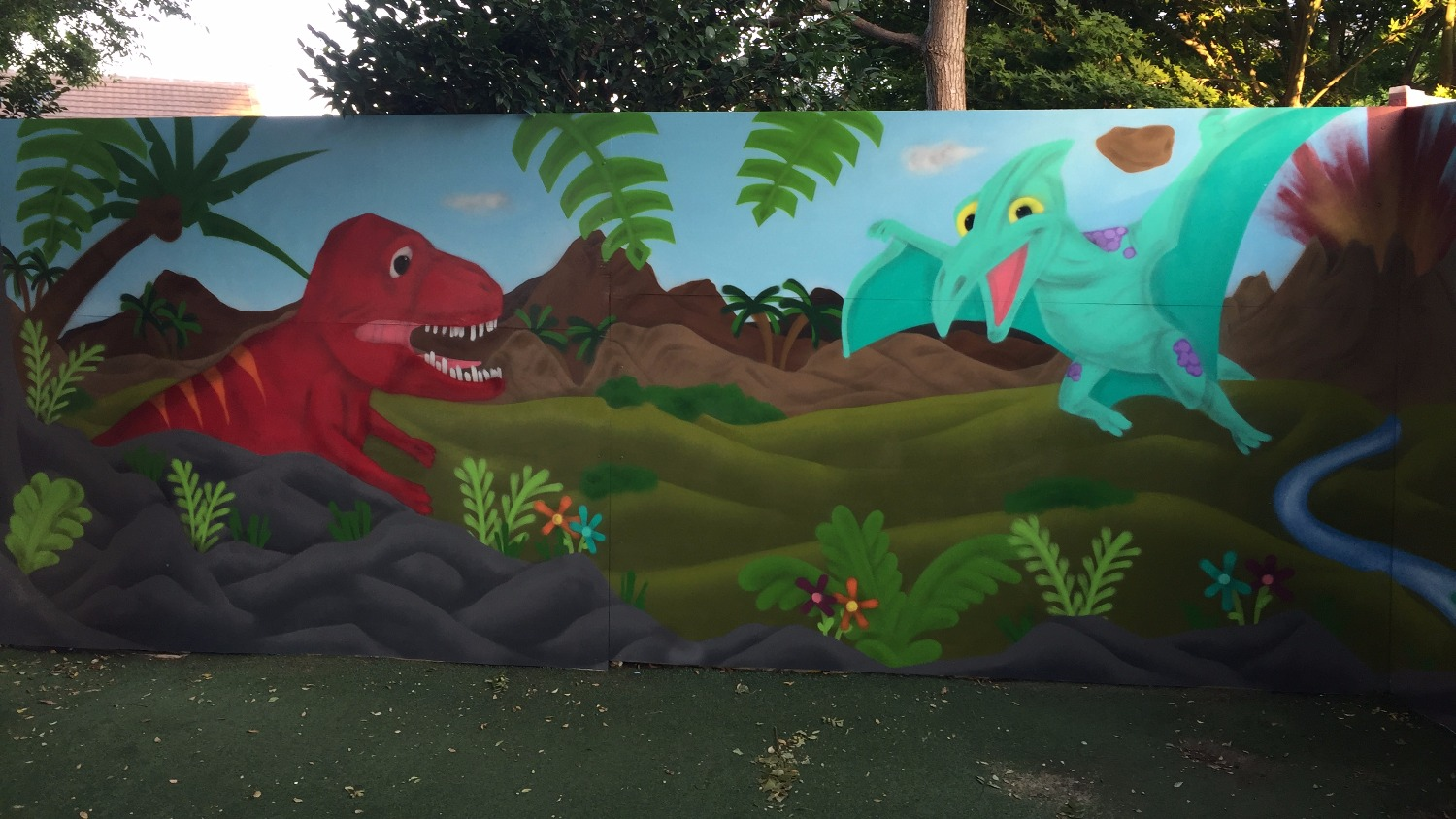 Dinosaur mural painted at preschool