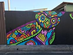 Owl street art mural by Jyiro