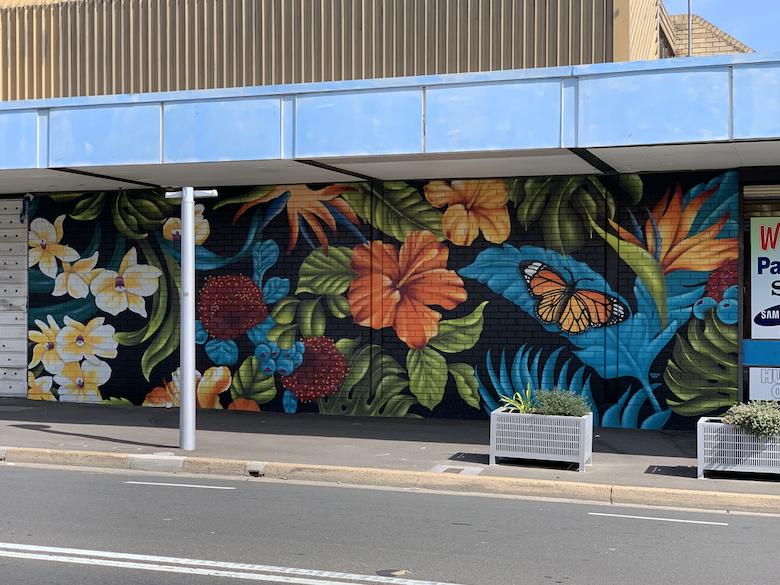 Tropical floral graffiti art mural by urban art