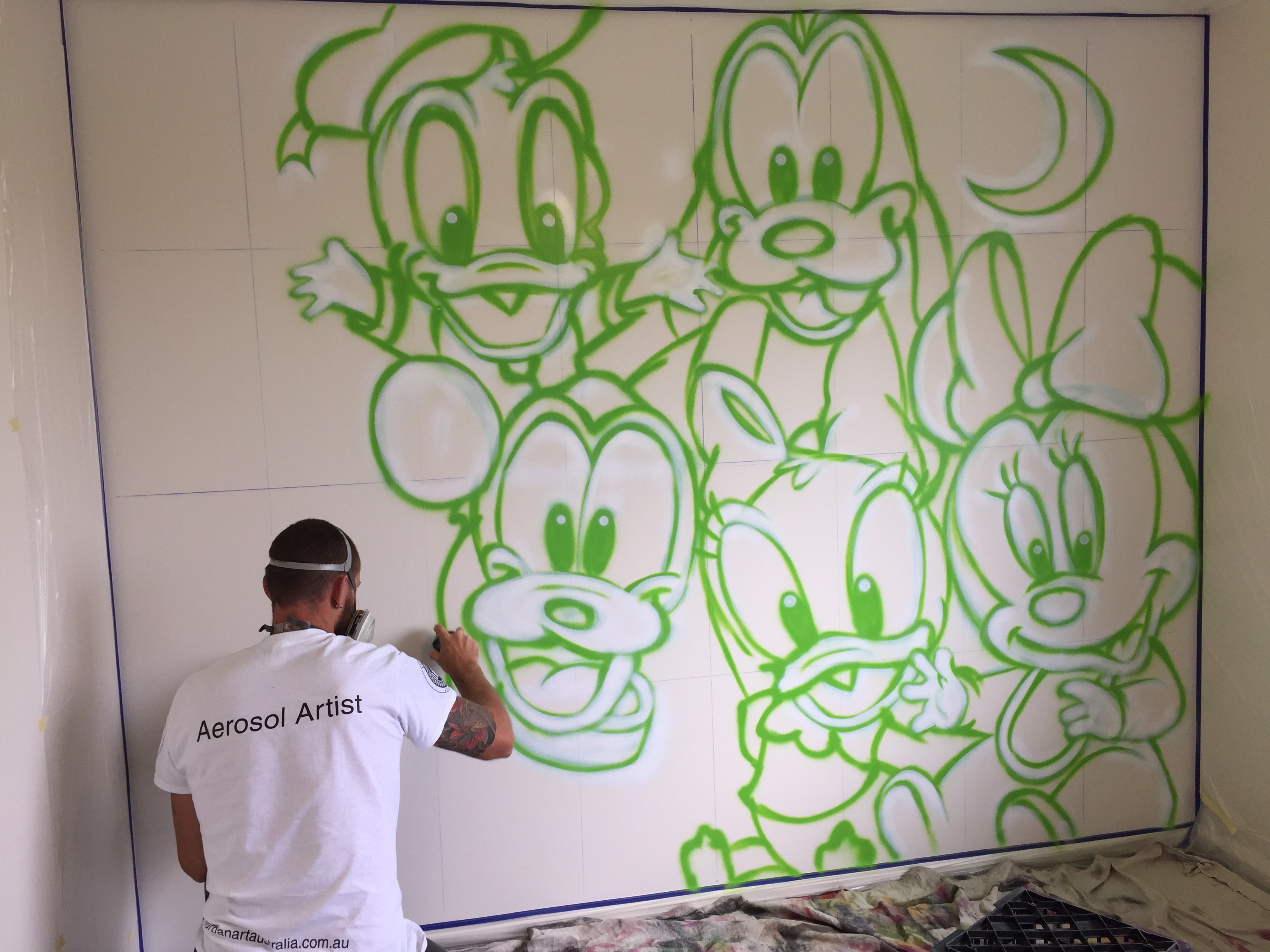 artist painting Disney kids bedroom