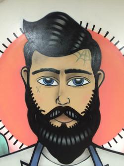 Close up of barber street art mural