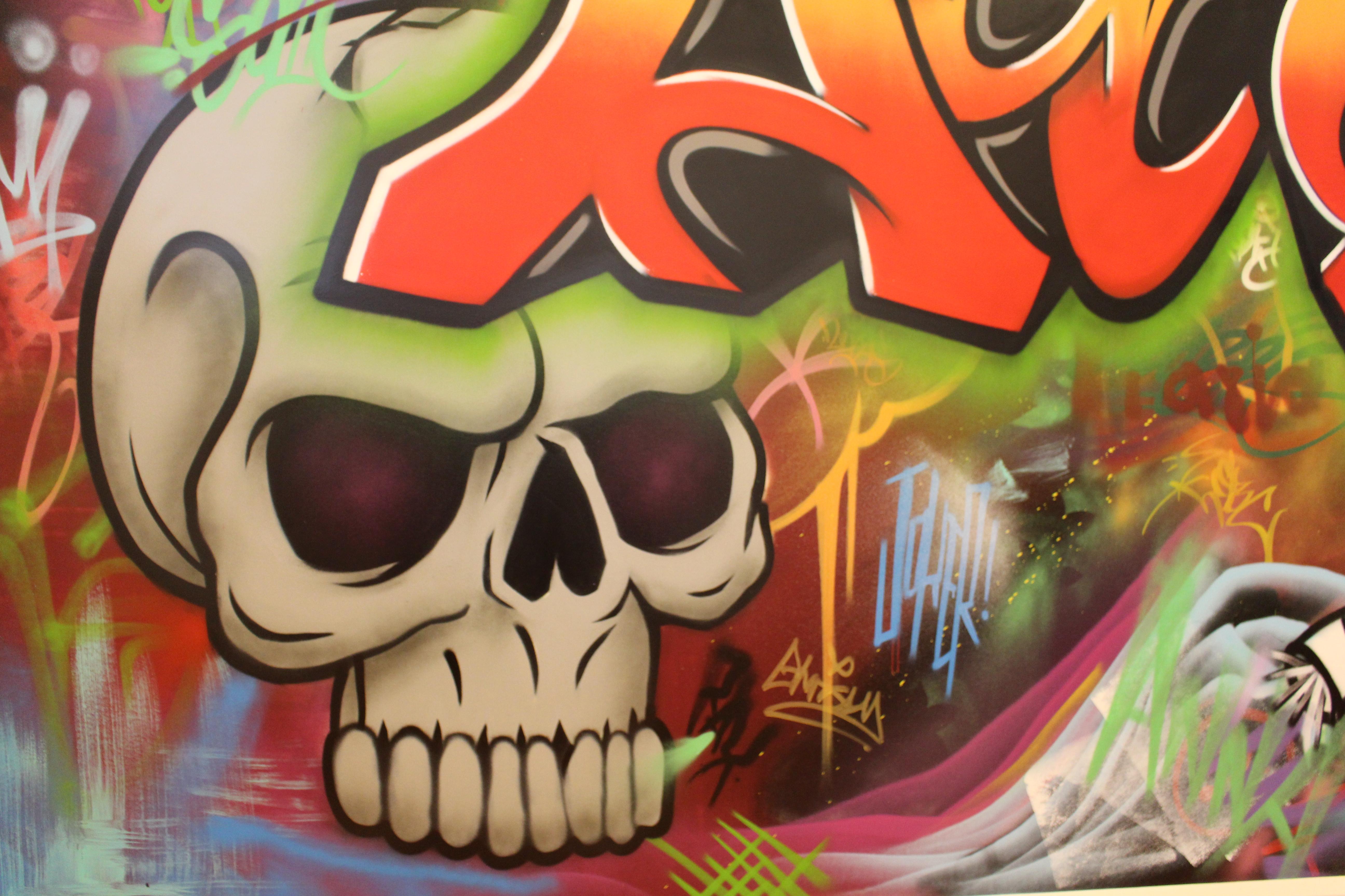 skull and graffiti wall art