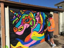 Jyiro painting rainbow unicorn