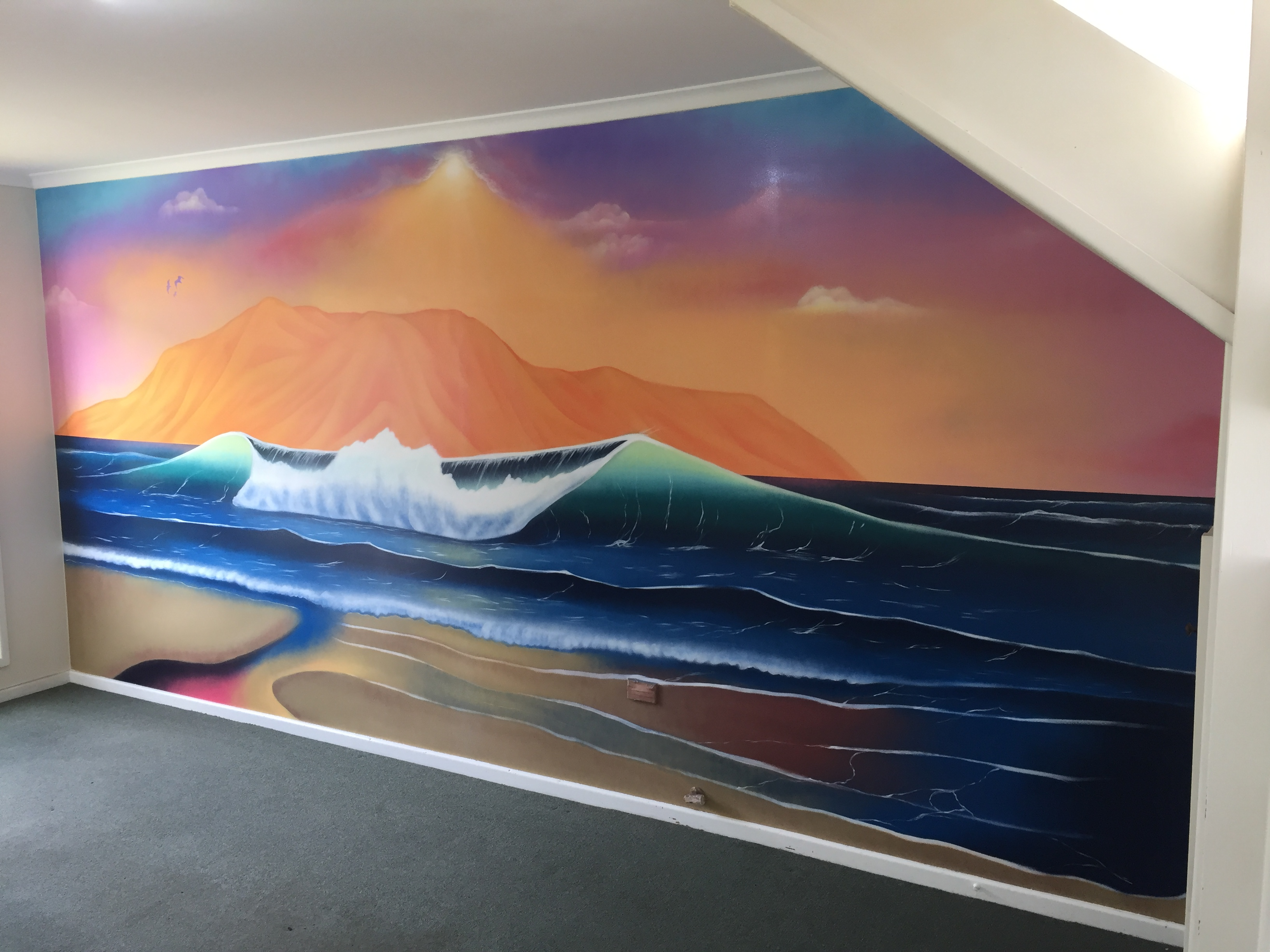 Mural of ocean waves painted in home