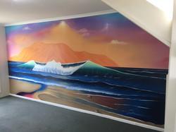 Mural of ocean waves painted in home