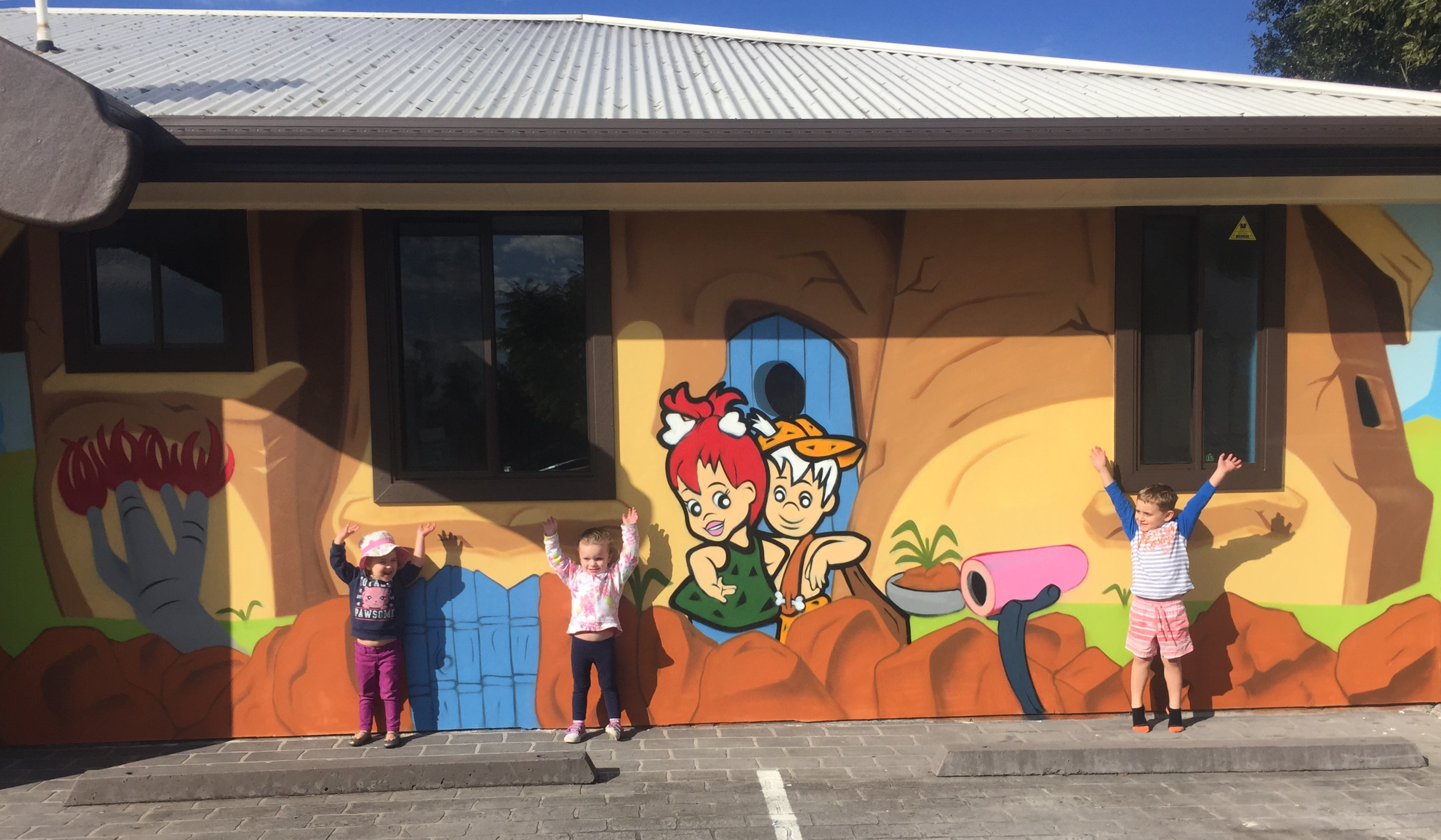 kids happy with their new mural