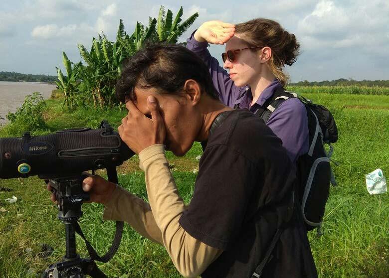 Imam and Sarah scanning shorebirds at Kali Progo estuary, Jogja