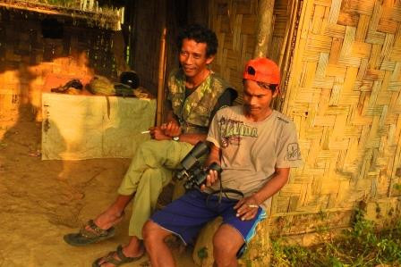 Heru (left) and local guide sitting on the shelter