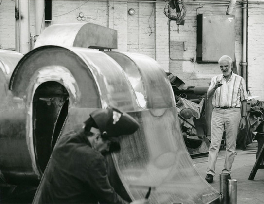 Anthony Caro working on Elephant Palace with Patrick Cunningham, 1989