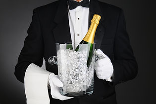 Closeup of a Sommelier holding a Champag